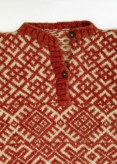 Russian traditional costume. Detail of a knitted sweater with sacred patterns. Arkhangelsk Province, 19th century. #folk #textile
