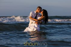 Christine and Jason kissing in the water for their Trash the Dress anniversary photo shoot. By @Shaun King of Shaun King Photography #water #kissing #trashthedress
