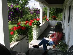 Summers on the front porch.  A porch helps keep the house cool.