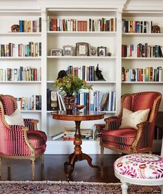 Sarah and the team installed bookshelves in an old doorframe to convert a full wall in this living room into a library. An Italian marquetry table, paired with French wing chairs — recovered in cut velvet — offers a perfect spot to plan the day.