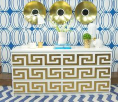 Colin & Justin Design | Greek-key sections sprayed with gold paint to Ikea cabinet | EQ3 Rug | Blue Mountain Wallpaper | Gold Bowl Wall Hangings