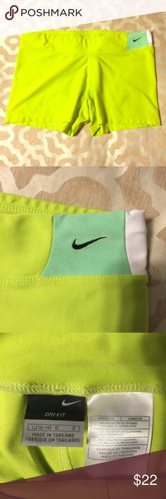 Woman's Nike Spandex Shorts Lime green Nike spandex shorts with decorative logo in teal patch on hip. In great shape! I just don't play volleyball anymore. Nike Shorts