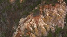 """Georgia's Providence Canyon is commonly called, """"Little Grand Canyon."""" The canyon-like features are actually a result of erosion caused by poor farming practices."""