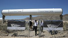 People tour the site after a test of a Hyperloop One propulsion system, Wednesday, May 11, 2016, in North Las Vegas, Nev. The startup company opened its test site outside of Las Vegas for the first public demonstration of technology for a super-speed, tube based transportation system.