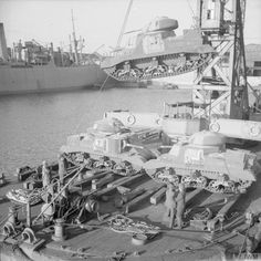 American M3 Grant tanks being unloaded from ships at a British port, 29th June…