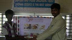 Food being donated to the child by one of the co-ordinator of the orphanage in the event