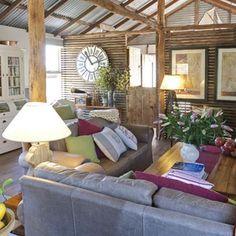 Shearing Shed interior - love the raw beams and wooden clad separating wall.