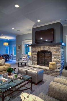 Basement with fireplace built by Zimmer builders, designed with Udvari-Solner Design Company