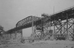The Clark Avenue Bridge, Cleveland, over the Cuyahoga River. Built in 1912, it was Cleveland's longest bridge at 6,687 feet. The old Clark Avenue Bridge was torn down in the mid-1980s, due to deterioration caused by chemicals in the smoke from the steel mills below the bridge. Like the Detroit-Superior Bridge, it had its own street car tracks. It was replaced by I-490 Bridge. Cleveland Baseball, Cleveland Rocks, Cleveland Ohio, Steel Mill, The Buckeye State, Ohio Usa, County Seat, North Coast, Photo Journal