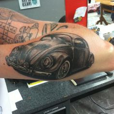 VW Bug tattoo by Bones @ Bones Tattoo and Barber Co   This is so bad ass! I want to get a Vw bug fix it up w my husband and then get a bad ass tattoo like this of it!