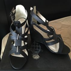 Stylish Wedge sandals New in the box! Got them as a gift and they don't fit  they have silver details and 2 silver buckles. Perfect to wear to work or to go out. Approximately 4 inch heel Boutique Shoes Wedges