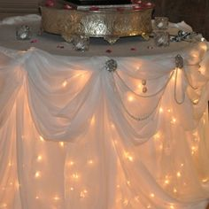 Maybe not as fancy as this but it would be cool to string Christmas lights under tables with white tablecloths where guests wouldn't be sitting like food tables and silent auction tables. Dream Wedding, Wedding Day, Trendy Wedding, Table Wedding, Rustic Wedding, Wedding Stuff, Elegant Wedding, Bridal Table, Wedding Pins