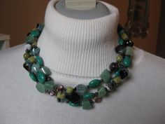 "Item #F1361 20"" 3-Strand Agate, Aventurine, Turquoise, Jade necklace. Silver-plated toggle clasp. $85."