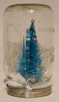 Bottle brush tree snowglobe by Candy Spiegel