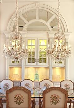 Elegant dining room with arched moldings, mirrored back and china cabinet with low voltage lighting. #montecristosofengland #diningroom #elegant