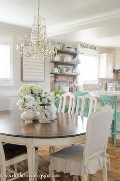 Love this kitchen and table, chairs. Make ruffle chair cushions from drop cloth.