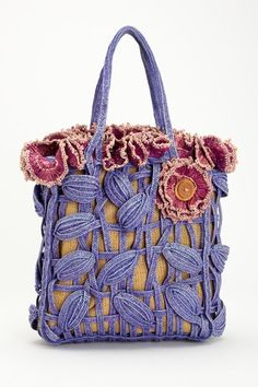 Jamin Puech - a Parisian line of handbags.   Love the floral details!