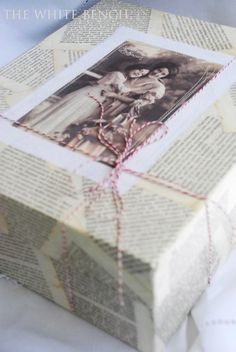 A shoe box completely covered in old book pages...