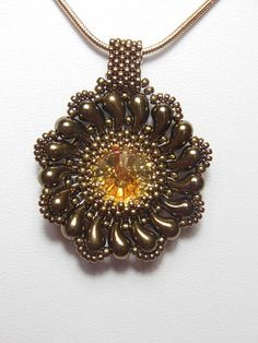 A step by step tutorial for a beautiful beaded pendant for you to make in the comfort of your own home. You will need to be familiar with peyote stitch to make this pendant. Instructions are only available in English. Tutorial contains photographs of the steps.