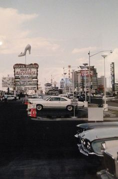 Parking lot of the Silver Slipper, 1968. Howard Hughes purchased the place in April of this year and had the slipper pointed away from where he slept, across the street at Desert Inn. ✿❀