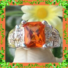 "NWOT: STERLING SILVER TOPAZ RING   Beautiful sterling silver orange topaz ring has exactly what it needs to be different and will surely get lots of attention.  It is even more beautiful in person.  It's absolutely glorious shine and brilliancy far surpasses the color of other rings of this nature.  The sides have an awesome design which is also an eye catcher.  Size 7.  Largest stone 1/4"" wide with crystals on each side which add additional width.  The height is 1/2"".   Jewelry Rings"