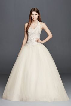 Make your grand entrance andchannel royal appeal in this tulle halter wedding dress. Featuring a basque waist, beaded embroidery, and ball gown silhouette this gown will be cherished for years to come.  David's Bridal Collection.  Also available in Plus Size.Check your local stores for availability.  Fully lined. Imported polyester. Back zipper. Dry clean.  Cherish your wedding dress forever with our Gown Preservation Kit.