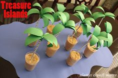 Treasure Island Pirate Party Game - SO FUN! Make playdough, hide in treasure, and make the palm trees with paper straws and construction paper. Great party decor and party activity in one!