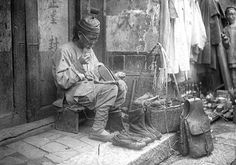 Poor shoe repairman during the late Qing dynasty.
