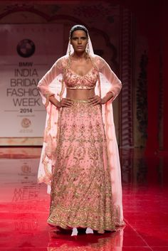 Pink and gold Indian wedding lehnga by Suneet Varma. More here: http://www.indianweddingsite.com/bmw-india-bridal-fashion-week-ibfw-2014-suneet-varma/