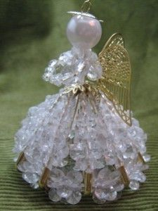 Bead angel  (I have a friend who has made me many beaded ornaments and they are so pretty--crystals, pearls--I love them)