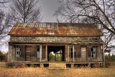 - Dogtrot House -We used to see these houses fairly often in the rurals of Arkansas.  Not so much anymore.  So sad, an era gone.