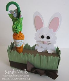 thinking to do the bunny holding the carrot filled w/m&ms
