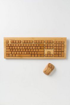Bamboo Keyboard & Mouse. Of course, brought to you by Anthropologie... le sigh.