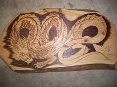 Pyrography Dragon WIP by WOODEWYTCH.I  like dragons to have a 'stache