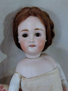 """Lovely 18"""" Kestner, young lady fashion doll made in Germany  circa 1890. Her head is marked with the size number only """"7 ½"""". She has a human hair wig"""