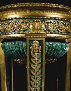 A rare pair of Restauration Ormolu and Malachite Athéniennes circa signed Thomire a Paris Estimate — USD LOT SOLD. USD (Hammer Price with Buyer's Premium)