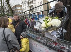 Families gather to add their tribute outside the famous studios. The statement added: 'We are committed to ensuring Sir George's visionary legacy lives forever at Abbey Road Studios, and we are hugely honoured to be part of his story'