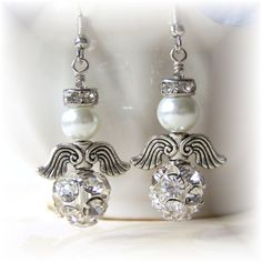 Check ebay for wing beads - halo is just a spacer, pearl bead head, look for fancy bottom bead to finish off. Use as Christmas tree decoration.angel earrings