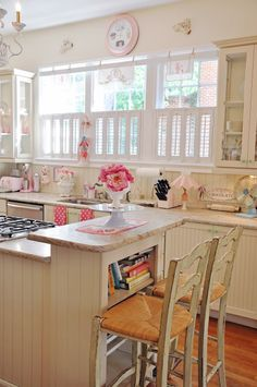 A happy little cottage kitchen...so pretty white cabinets and shutters bead board island - dual level