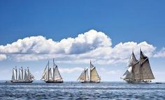 The Mary Day, right, sails in a race against other members of Maine's windjammer fleet off Rockland, Maine.