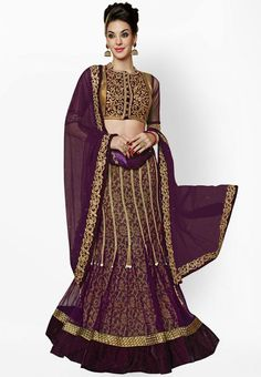 Pick this semi-stitched lehenga set from Mahotsav to look absolutely gorgeous and stunning on any special occasion. This wine coloured semi-stitched lehenga set features a fabulous design and is certainly a fine example of craftsmanship. Made from net, it is light in weight and quality assured. -www.cooliyo.com