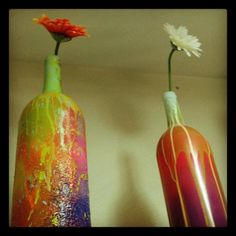 reuse your empty wine bottles by spray painting them