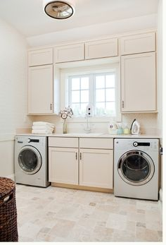 laundry/bathroom ideas. I would place the washer and dryer next to each other with cabinets on each side.