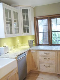 In this Madison, Wisconsin kitchen remodel, designer Jenny Schuchardt of Marling HomeWorks successfully uses white cabinets and light wood cabinets to produce a clean, classic look. The upper cabinets are Fieldstone Cabinetry's DeWitt inset door style in Maple finished in America's favorite cabinet color: White. The same door style—DeWitt in Maple—is used to create the lower cabinets. The lower cabinets were finished in Natural: no color, just clear, to let the beautiful grain show.