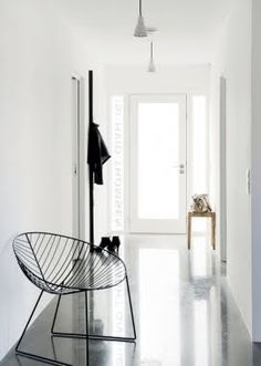 .minimalism...  strip gross woodwork out of gross ranches, install windowed doors to bring in the light and play up their simplicity. works well.