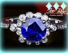 Ceylon Blue Sapphire Engagement Ring 1.10ct Round set in a 14k White gold bezel set diamond halo setting