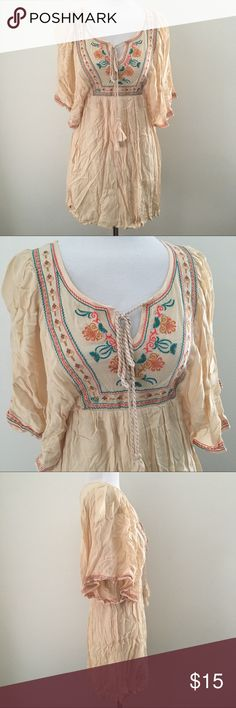 """BOHO SOUTHWEST SILKY BLOUSE TUNIC DRESS SHIRT TOP! Beautiful Vintage Beige-Cream-Tan/Coral/Turquoise/Mustard Embroidered Silky Lightweight Sheer Blouse Tunic Shirt Top Boho Hippie Festival 70's Vibes Western Southwest Southwestern.  *Could double as a mini dress if you're 5'2"""" or shorter.  Brand new. Never used. NO flaws.  Tagged as a Women's Medium  •Chest-19"""" across •Length-31.5"""" long  Modeled on: •Women's size XS •33"""" chest (A/B cup) •24"""" waist  •Shell-100% rayon •Lining-100% polyester…"""