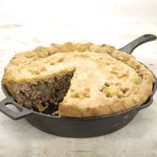 """Christmas Tourtiere Pie in a Cast Iron Skillet - For such a simple meat-filled pie, tourtière certainly has a vast number of different incarnations! As one French baker we know says, """"There are as many recipes for tourtière as there are cooks in Quebec."""" The meat can range from pork, chicken, or beef, to lamb, veal, or even duck. Some pies are simply meat and onions; others include potatoes and/or celery as well. --- http://www.kingarthurflour.com/recipes/christmas-tourtiere-recipe"""
