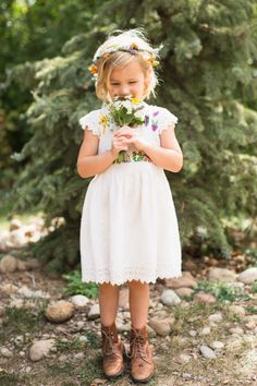 White lace flower girl dress with cute as can be embroidery.   Photography: EB+JC Photography - www.ebplusjc.com/