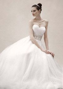 This ultra luxe ball gown combines fairy-tale romance with modern glamour forlook that is sure to wow.  Strapless sweetheart bodice is feminine and flattering.  Beaded belt, flawlessly sewed into gown, cinches the waist to create curves while adding opulance and sparkle.  Tulle ball gown skirt gives this style volume and is the perfect complement to the fitted bodice.  Notrain. Available in stores in White. Available for special order in Soft White.  Petite: Style 7CPK440. Sizes 0P-…